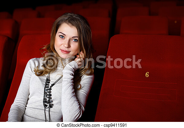 Young girl in cinema watching movie - csp9411591