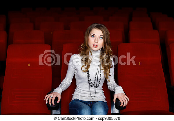 Young girl in cinema watching movie - csp9385578
