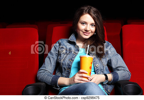 Young girl in cinema watching movie - csp9298475