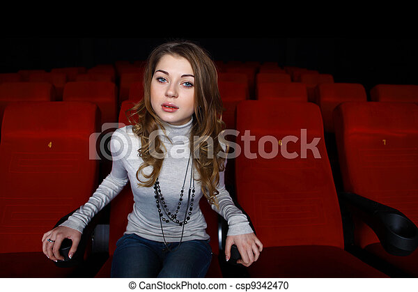 Young girl in cinema watching movie - csp9342470