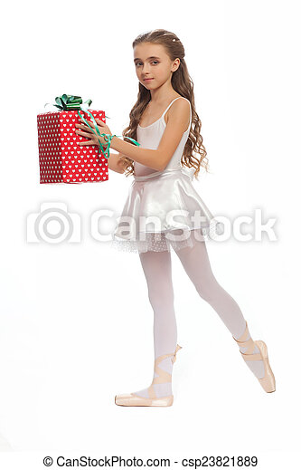 e322527b7101 young girl in her dance clothes reaching down to touch her foot with gifts  in hand