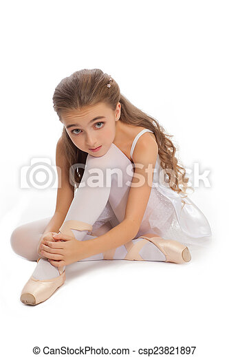 477c1c11865d Young girl in her dance clothes reaching down to touch her foot ...