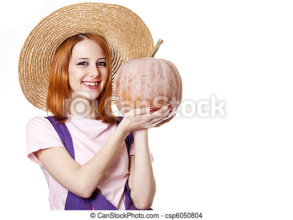 Young girl in overalls with pumpkin. - csp6050804