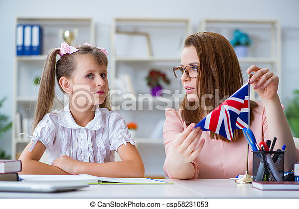 Young girl learning english with teacher - csp58231053