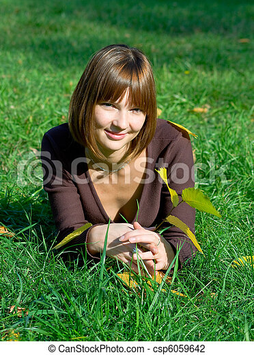 young girl on a green grass - csp6059642