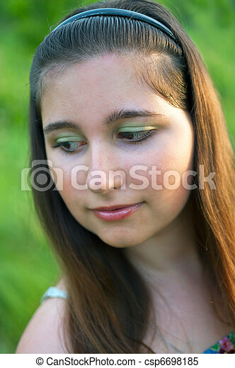 young girl on green background - csp6698185