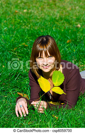 young girl on green grass - csp6059700