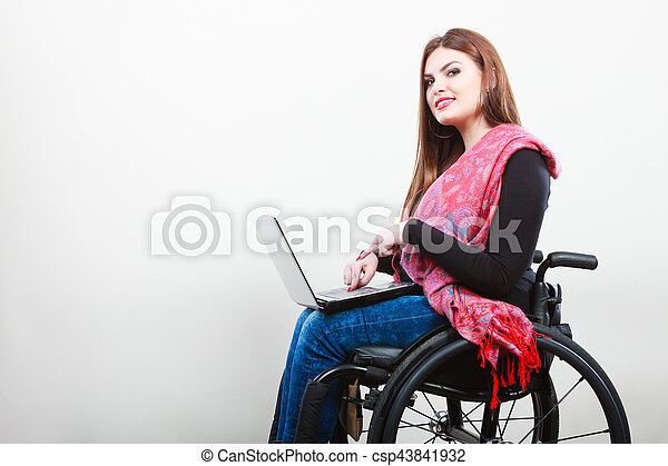 Young girl on wheelchair surfing web. - csp43841932
