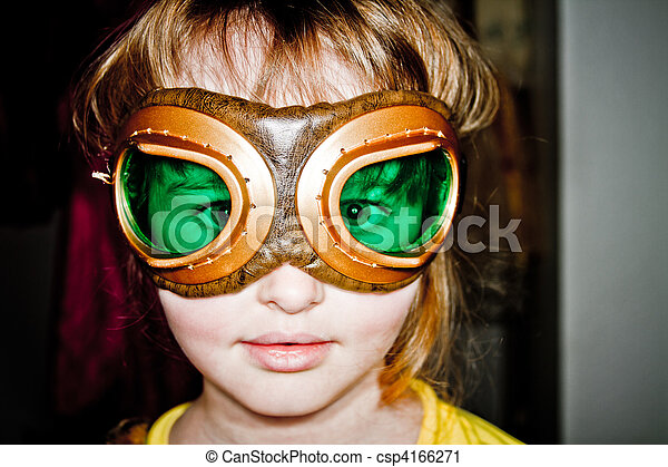 Young girl playing dressup with aviation goggles - csp4166271