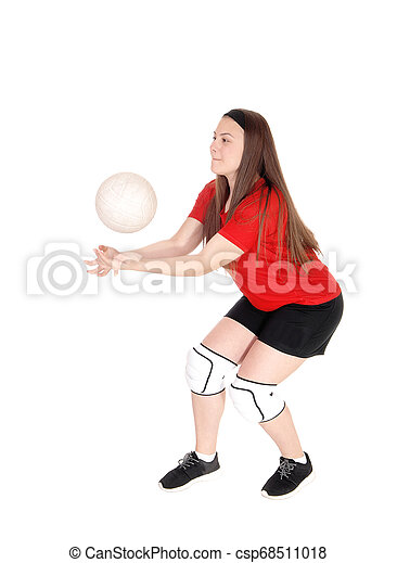 Young girl playing volley ball - csp68511018