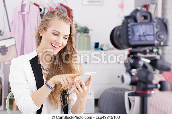 Young girl presents new smartphone - csp49245100