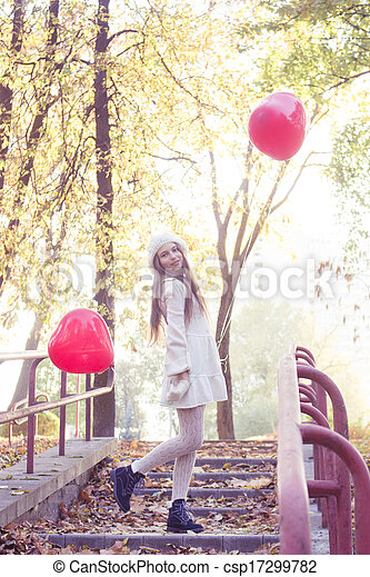 young girl walking in the autumn park - csp17299782