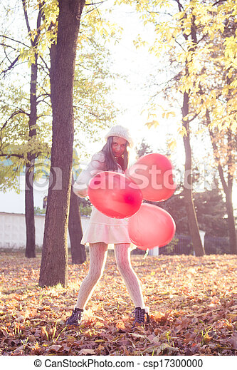 young girl walking in the autumn park - csp17300000