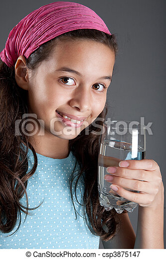 Young girl with a glass of water, concept of healthy lifestyle - csp3875147