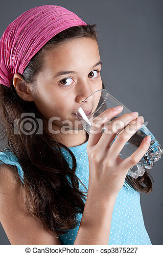 Young girl with a glass of water, concept of healthy lifestyle - csp3875227
