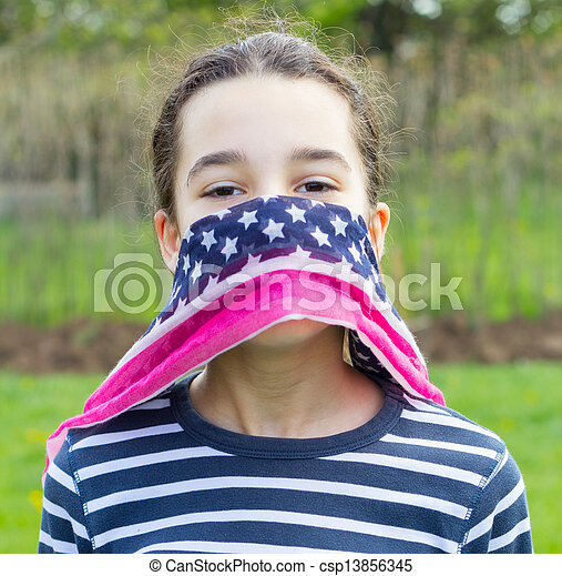 young girl with American flag scarf - csp13856345