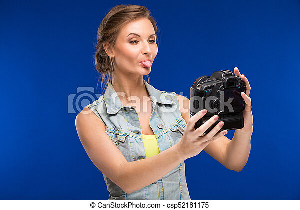 young girl with camera in hand - csp52181175