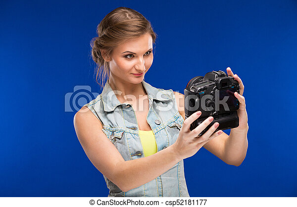 young girl with camera in hand - csp52181177