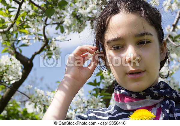 young girl with cherry blossom - csp13856416
