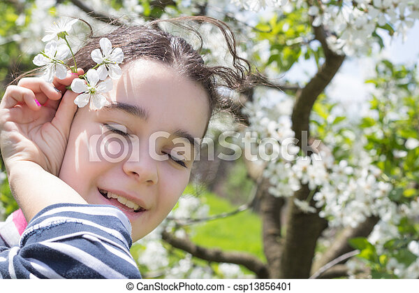 young girl with cherry blossom - csp13856401