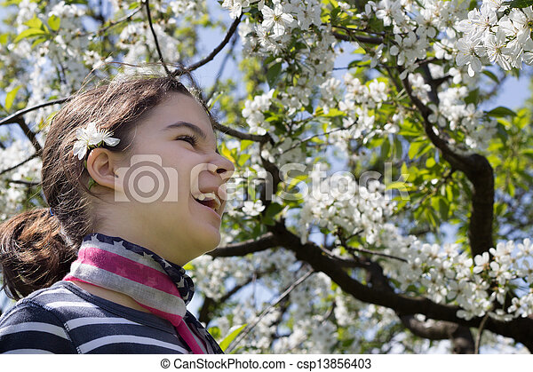 young girl with cherry blossom - csp13856403