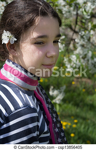 young girl with cherry blossom - csp13856405