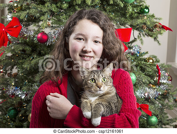 Young Girl with Family Pet during Holidays - csp12161061