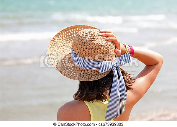 Young girl with straw hat - csp73939303