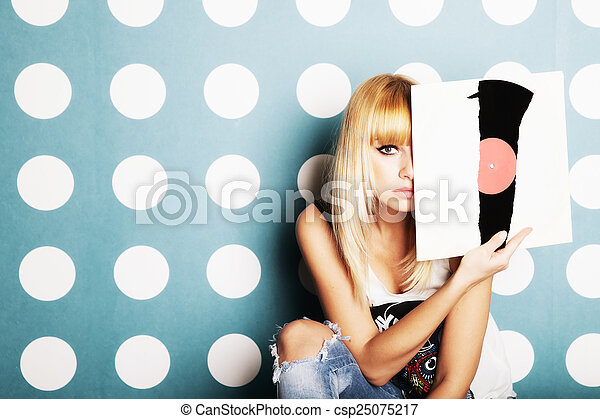 Young girl with vinyl records in the hands - csp25075217