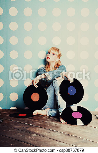 Young girl with vinyl records - csp38767879