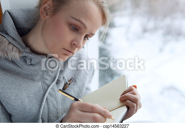 Young girl writing in her journal. - csp14563227