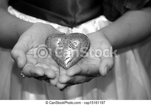 Young girl's hands holding heart - csp15161197