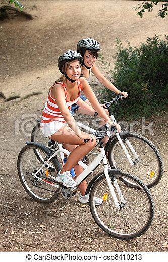 Teen riding bike