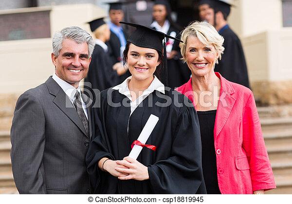 young graduate with parents - csp18819945