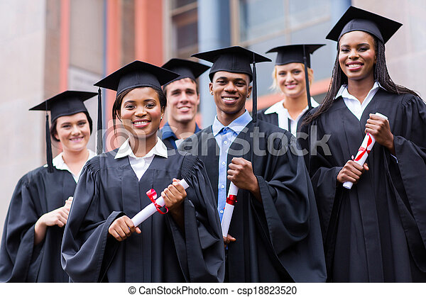 young graduates standing in front of university building - csp18823520
