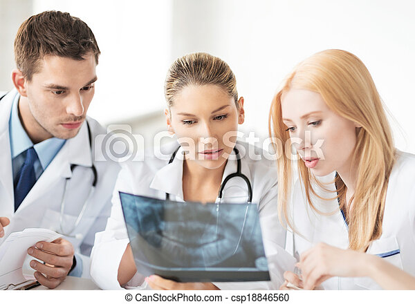 young group of doctors looking at x-ray - csp18846560