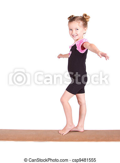 Young Gymnast balances on beam - csp9481555
