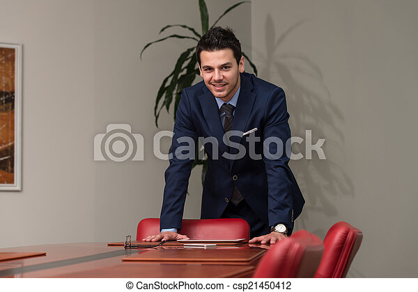 Young Handsome Businessman In Blue Suit - csp21450412