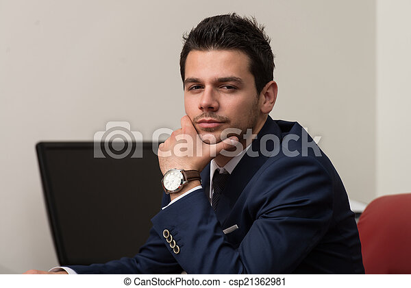 Young Handsome Businessman In Blue Suit - csp21362981