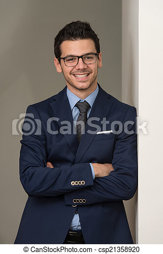 Young Handsome Businessman In Blue Suit - csp21358920