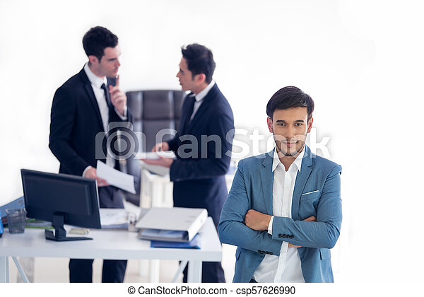Young handsome businessman with blue suit - csp57626990