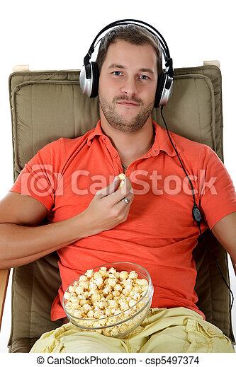 Young handsome caucasian man, headphones - csp5497374