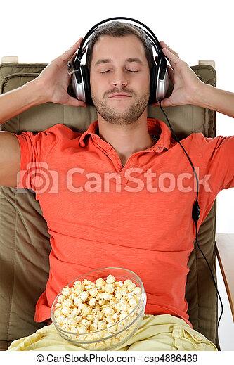 Young handsome caucasian man, headphones - csp4886489
