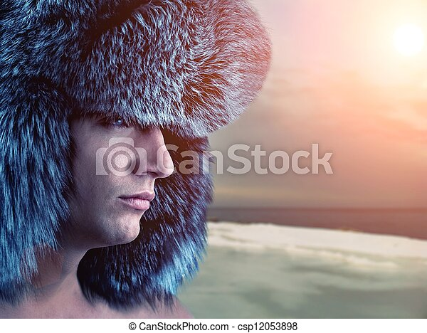 Young handsome man against sunset - csp12053898