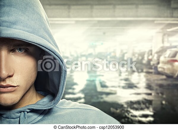 Young handsome man in a hood  - csp12053900