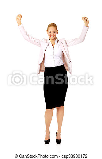 Young happy business woman with arms up - csp33930172