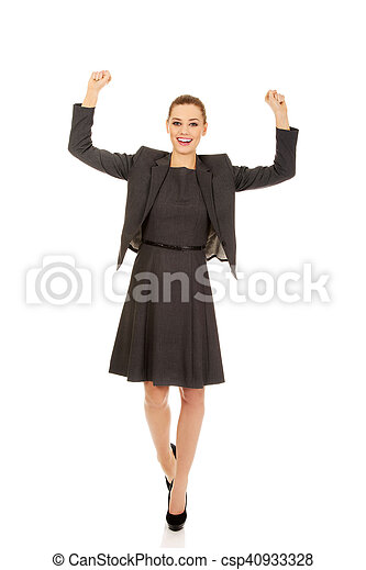 Young happy business woman with arms up - csp40933328