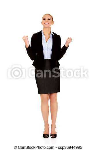 Young happy business woman with arms up - csp36944995