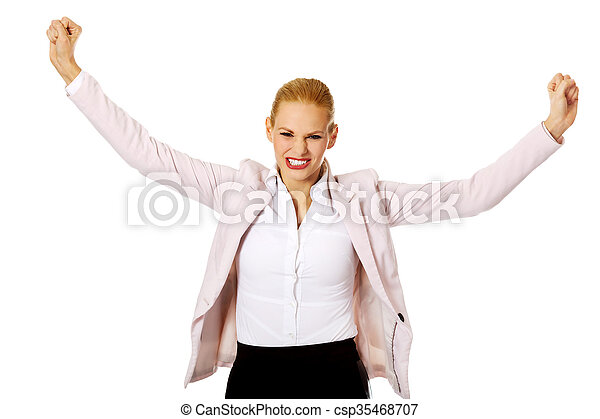 Young happy business woman with arms up - csp35468707