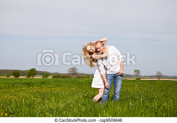 young happy couple have fun in summer - csp9509646